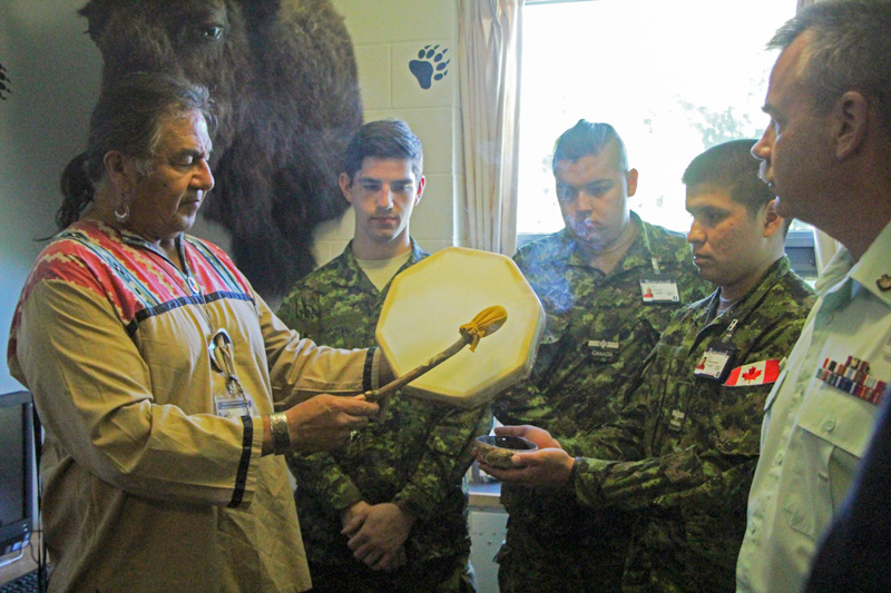 Aboriginal Leadership Opportunity Year (ALOY) officer cadets with Elder Bernard Nelson