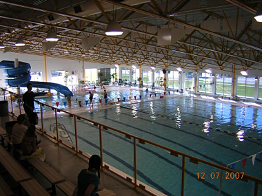 View of the large pool, small pool and water slide from the viewing area