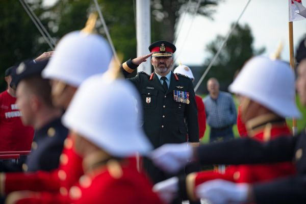 A general officer ex-cadet of RMC salutes officer cadets in a march past